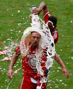 Bayern's Boateng pouring beer over Ribery to celebrate winning the Bundesliga
