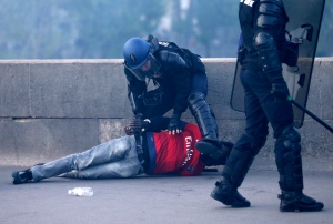 A PSG fan who clashed with police in Paris being arrested. Hundreds of PSG supporters took to the streets after their Ligue 1 title was confirmed